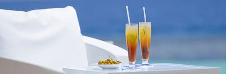 Outdoor Dining Area at Kandolhu Maldives